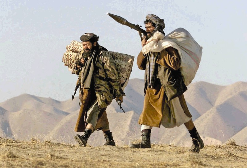 epa02919078 (FILE) A file picture dated 07 November 2001 shows Northern Alliance soldiers carrying their belongings as they walk to the front line with Taliban forces in Qala Cata mountains, northern Afghanistan. The tenth anniversary of the invasion of Afghanistan is marked on 07 October 2011. On 07 October 2001 the United States of America launched Operation Enduring Freedom in Afghanistan in response to the terrorist attacks on the United States of 09 September 2001. The stated goal was to dismantle the Al Qaeda terrorist organization and end its use of Afghanistan as a base. The military campaign also aimed to remove the ruling Taliban regime from power and create a viable democratic state.  EPA/SERGEI CHIRIKOV ***PLEASE REFER TO THE ADVISORY NOTICE epa02919044 FOR COMPLETE FEATURE TEXT***