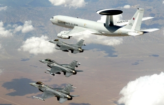 EDWARDS AIR FORCE BASE, Calif. -- A NATO Airborne Warning and Control System aircraft flies with three F-16s during a recent test mission . The AWACS were here to conduct airborne interoperability testing on the Link-16, part of the F-16 Mid-Life Upgrade test program. (U.S. Air Force photo by Tom Reynolds)